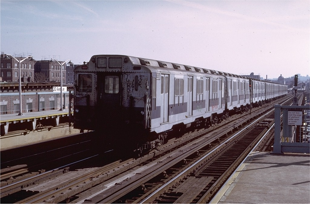 (202k, 1024x673)<br><b>Country:</b> United States<br><b>City:</b> New York<br><b>System:</b> New York City Transit<br><b>Line:</b> BMT West End Line<br><b>Location:</b> 20th Avenue <br><b>Route:</b> B<br><b>Car:</b> R-10 (American Car & Foundry, 1948) 3311 <br><b>Photo by:</b> Doug Grotjahn<br><b>Collection of:</b> Joe Testagrose<br><b>Date:</b> 12/1974<br><b>Viewed (this week/total):</b> 9 / 3676