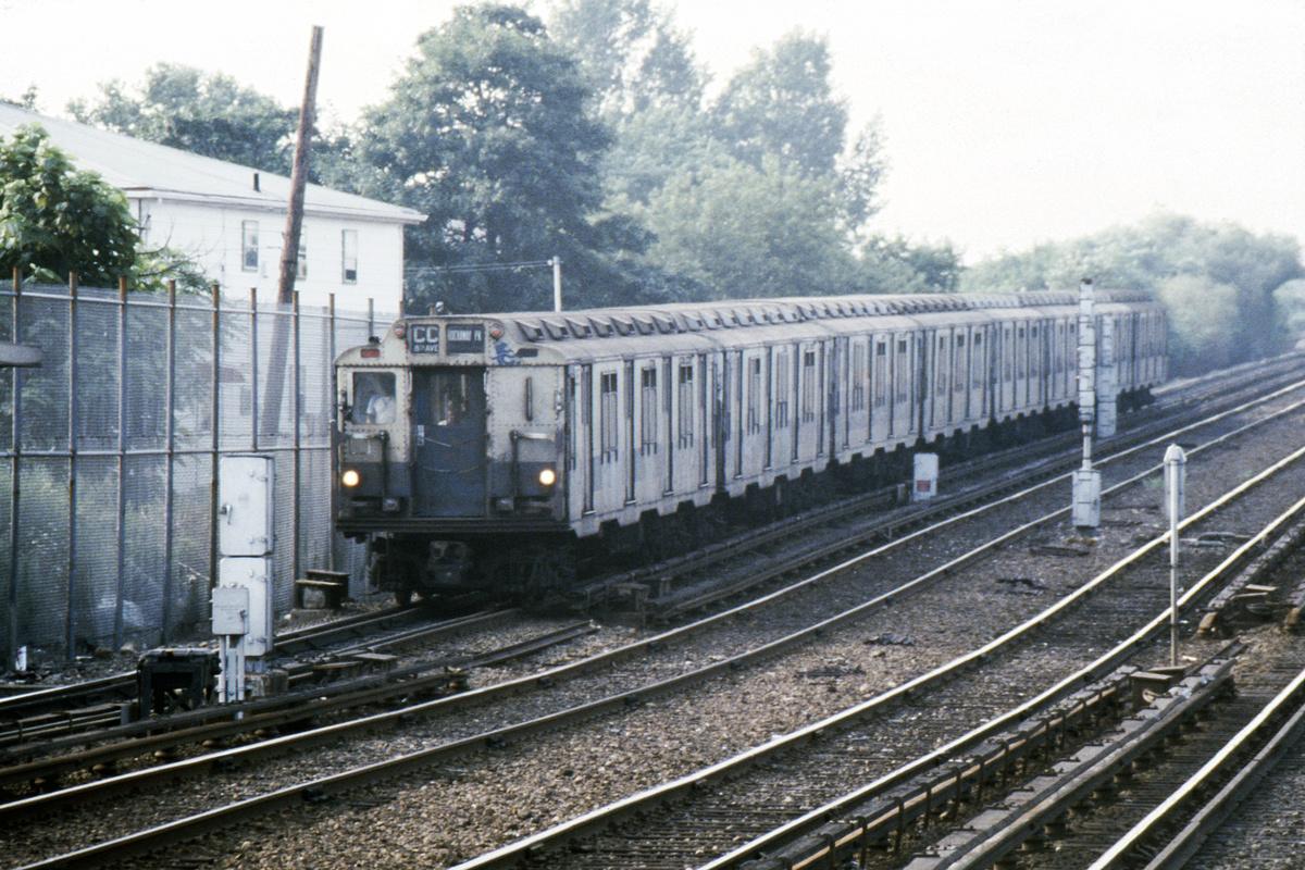 (508k, 1044x710)<br><b>Country:</b> United States<br><b>City:</b> New York<br><b>System:</b> New York City Transit<br><b>Line:</b> IND Rockaway<br><b>Location:</b> Howard Beach <br><b>Route:</b> A<br><b>Car:</b> R-10 (American Car & Foundry, 1948)  <br><b>Photo by:</b> Steve Hoskins<br><b>Collection of:</b> David Pirmann<br><b>Date:</b> 8/1979<br><b>Viewed (this week/total):</b> 4 / 5308