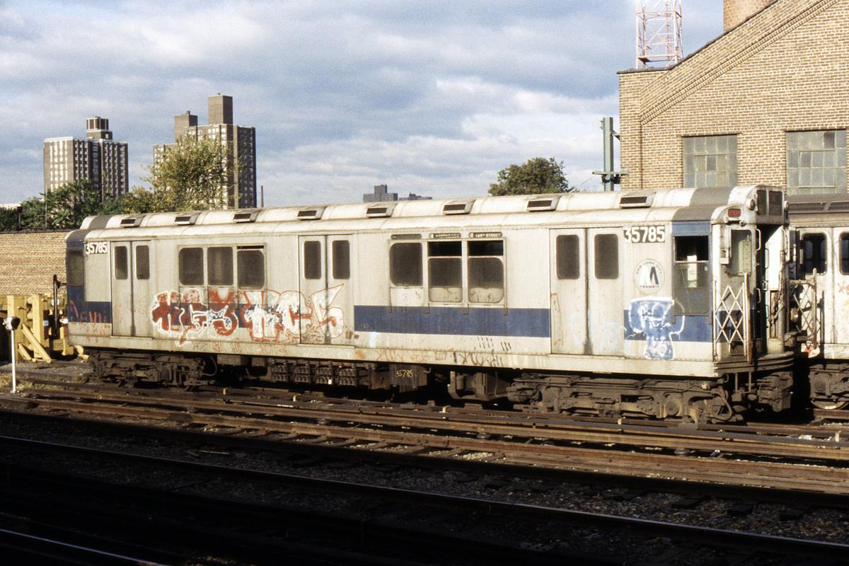 (561k, 1044x716)<br><b>Country:</b> United States<br><b>City:</b> New York<br><b>System:</b> New York City Transit<br><b>Location:</b> East 180th Street Yard<br><b>Car:</b> R-12 (American Car & Foundry, 1948) 35785 (ex-5785)<br><b>Photo by:</b> Steve Hoskins<br><b>Collection of:</b> David Pirmann<br><b>Date:</b> 10/1980<br><b>Notes:</b> Work service<br><b>Viewed (this week/total):</b> 1 / 6673