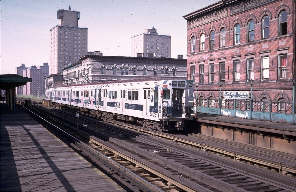 (259k, 1024x665)<br><b>Country:</b> United States<br><b>City:</b> New York<br><b>System:</b> New York City Transit<br><b>Line:</b> 3rd Avenue El<br><b>Location:</b> Claremont Parkway <br><b>Route:</b> 8<br><b>Car:</b> R-14 (American Car & Foundry, 1949) 5805 <br><b>Photo by:</b> Steve Zabel<br><b>Collection of:</b> Joe Testagrose<br><b>Date:</b> 1973<br><b>Viewed (this week/total):</b> 4 / 6605
