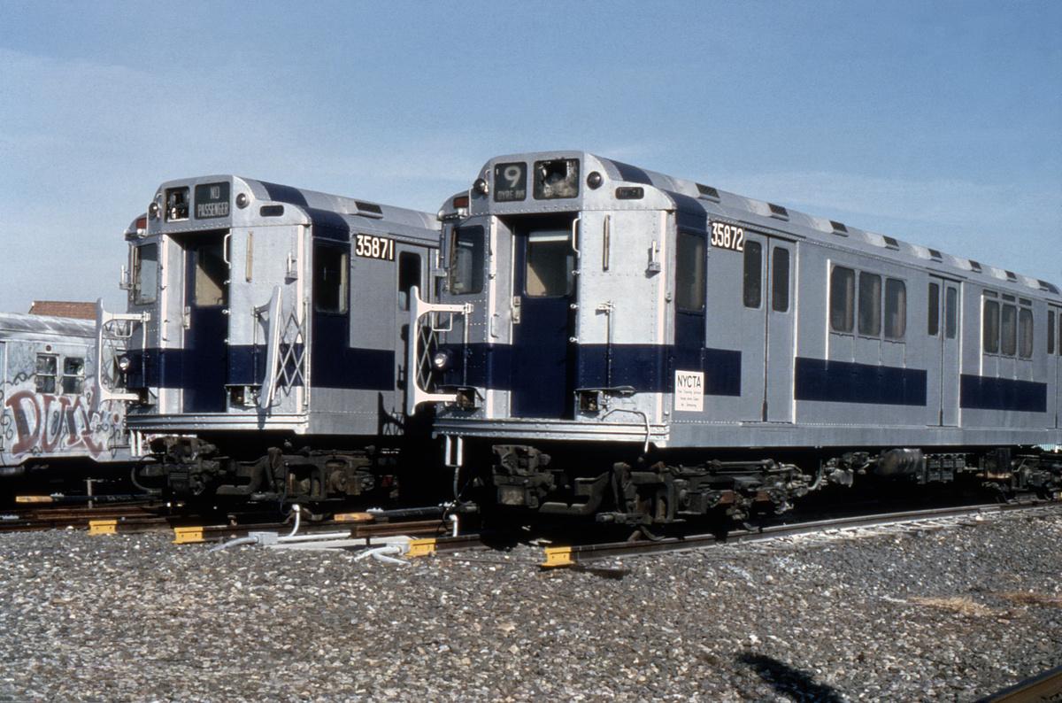 (235k, 1024x676)<br><b>Country:</b> United States<br><b>City:</b> New York<br><b>System:</b> New York City Transit<br><b>Location:</b> Coney Island Yard<br><b>Car:</b> R-14 (American Car & Foundry, 1949) 35871/35872 <br><b>Photo by:</b> Steve Zabel<br><b>Collection of:</b> Joe Testagrose<br><b>Date:</b> 12/22/1981<br><b>Notes:</b> Fire training cars.<br><b>Viewed (this week/total):</b> 4 / 8473