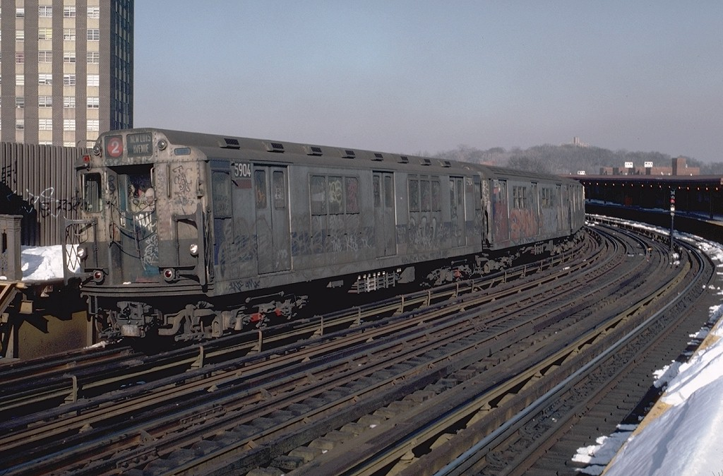 (198k, 1024x674)<br><b>Country:</b> United States<br><b>City:</b> New York<br><b>System:</b> New York City Transit<br><b>Line:</b> IRT White Plains Road Line<br><b>Location:</b> West Farms Sq./East Tremont Ave./177th St. <br><b>Route:</b> 2<br><b>Car:</b> R-14 (American Car & Foundry, 1949) 5904 <br><b>Photo by:</b> Doug Grotjahn<br><b>Collection of:</b> Joe Testagrose<br><b>Date:</b> 2/13/1983<br><b>Viewed (this week/total):</b> 2 / 5409