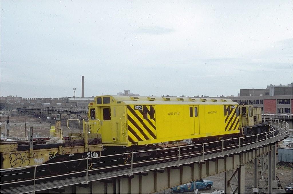 (204k, 1024x680)<br><b>Country:</b> United States<br><b>City:</b> New York<br><b>System:</b> New York City Transit<br><b>Line:</b> BMT West End Line<br><b>Location:</b> Bay 50th Street <br><b>Car:</b> R-71 Rider Car (R-17/R-21/R-22 Rebuilds)  RD325 (ex-5843)<br><b>Photo by:</b> Steve Zabel<br><b>Collection of:</b> Joe Testagrose<br><b>Date:</b> 12/7/1971<br><b>Viewed (this week/total):</b> 0 / 4688
