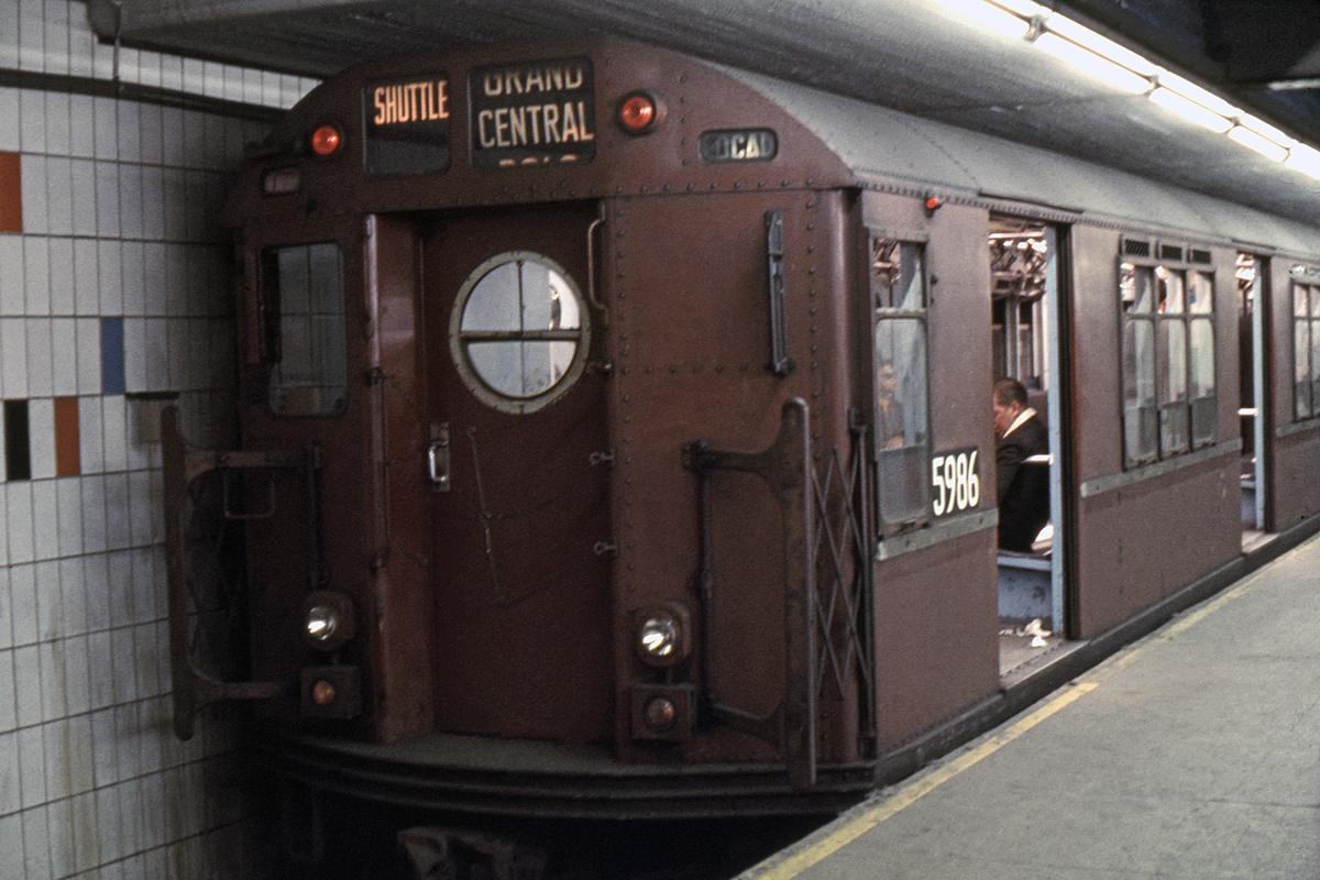 (164k, 1024x685)<br><b>Country:</b> United States<br><b>City:</b> New York<br><b>System:</b> New York City Transit<br><b>Line:</b> IRT Times Square-Grand Central Shuttle<br><b>Location:</b> Grand Central <br><b>Car:</b> R-15 (American Car & Foundry, 1950) 5986 <br><b>Photo by:</b> Doug Grotjahn<br><b>Collection of:</b> Joe Testagrose<br><b>Date:</b> 5/18/1969<br><b>Viewed (this week/total):</b> 4 / 7504