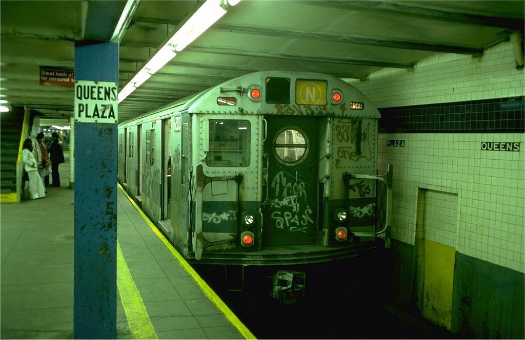 (173k, 1024x664)<br><b>Country:</b> United States<br><b>City:</b> New York<br><b>System:</b> New York City Transit<br><b>Line:</b> IND Queens Boulevard Line<br><b>Location:</b> Queens Plaza <br><b>Route:</b> N<br><b>Car:</b> R-16 (American Car & Foundry, 1955) 6303 <br><b>Photo by:</b> Doug Grotjahn<br><b>Collection of:</b> Joe Testagrose<br><b>Date:</b> 10/25/1976<br><b>Viewed (this week/total):</b> 0 / 6417