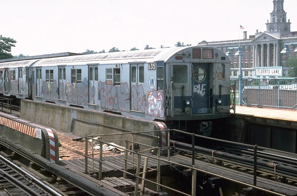 (212k, 1024x677)<br><b>Country:</b> United States<br><b>City:</b> New York<br><b>System:</b> New York City Transit<br><b>Line:</b> BMT Nassau Street/Jamaica Line<br><b>Location:</b> 75th Street/Elderts Lane <br><b>Route:</b> J<br><b>Car:</b> R-16 (American Car & Foundry, 1955) 6315 <br><b>Photo by:</b> Doug Grotjahn<br><b>Collection of:</b> Joe Testagrose<br><b>Date:</b> 6/29/1977<br><b>Viewed (this week/total):</b> 4 / 7710