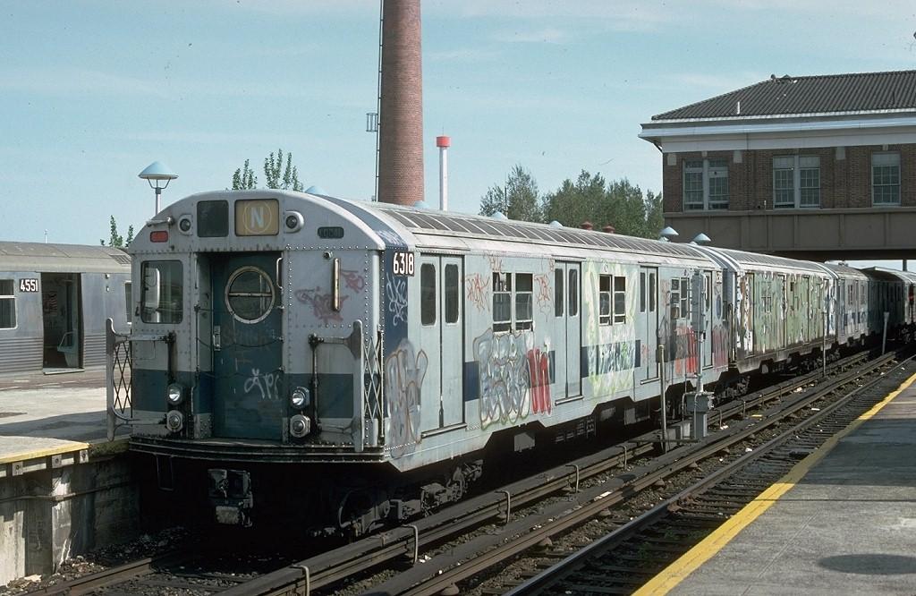 (208k, 1024x666)<br><b>Country:</b> United States<br><b>City:</b> New York<br><b>System:</b> New York City Transit<br><b>Location:</b> Coney Island/Stillwell Avenue<br><b>Route:</b> N<br><b>Car:</b> R-16 (American Car & Foundry, 1955) 6318 <br><b>Photo by:</b> Ed McKernan<br><b>Collection of:</b> Joe Testagrose<br><b>Date:</b> 5/13/1976<br><b>Viewed (this week/total):</b> 4 / 5121