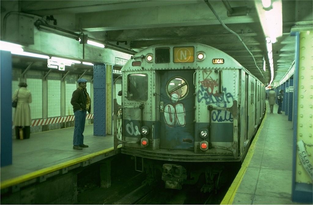 (168k, 1024x671)<br><b>Country:</b> United States<br><b>City:</b> New York<br><b>System:</b> New York City Transit<br><b>Line:</b> BMT Broadway Line<br><b>Location:</b> Whitehall Street <br><b>Route:</b> N<br><b>Car:</b> R-16 (American Car & Foundry, 1955) 6373 <br><b>Photo by:</b> Doug Grotjahn<br><b>Collection of:</b> Joe Testagrose<br><b>Date:</b> 12/7/1976<br><b>Viewed (this week/total):</b> 4 / 6868