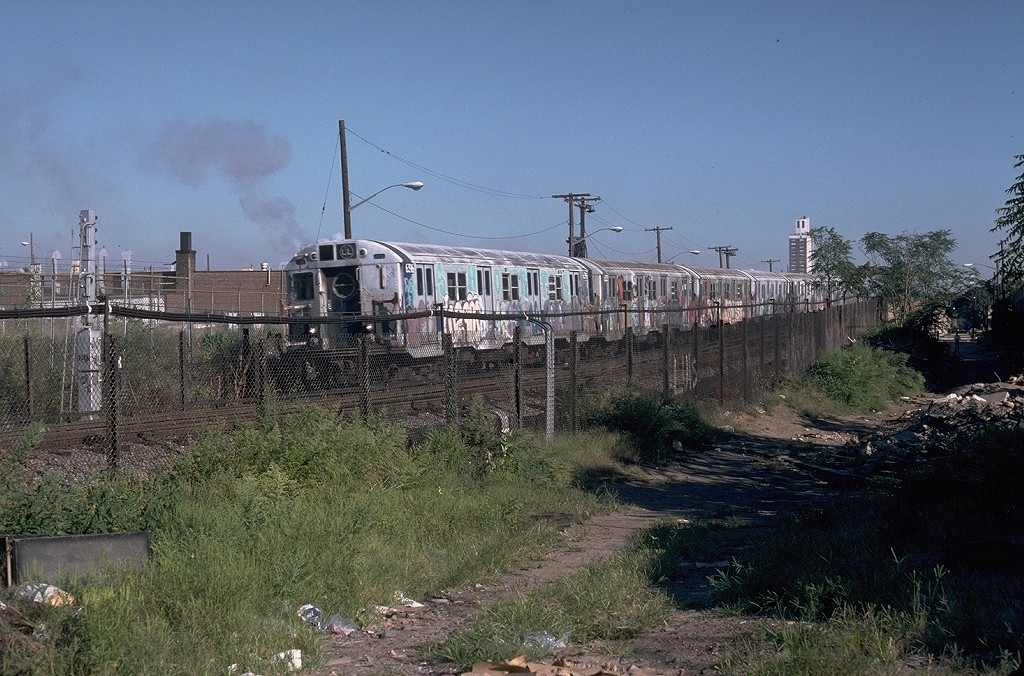 (246k, 1024x676)<br><b>Country:</b> United States<br><b>City:</b> New York<br><b>System:</b> New York City Transit<br><b>Line:</b> BMT Canarsie Line<br><b>Location:</b> East 105th Street <br><b>Route:</b> LL<br><b>Car:</b> R-16 (American Car & Foundry, 1955) 6396 <br><b>Photo by:</b> Doug Grotjahn<br><b>Collection of:</b> Joe Testagrose<br><b>Date:</b> 9/12/1979<br><b>Viewed (this week/total):</b> 1 / 7260