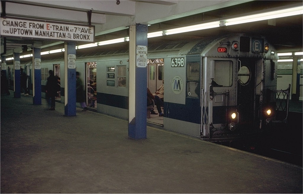 (170k, 1024x657)<br><b>Country:</b> United States<br><b>City:</b> New York<br><b>System:</b> New York City Transit<br><b>Line:</b> IND Queens Boulevard Line<br><b>Location:</b> 71st/Continental Aves./Forest Hills <br><b>Route:</b> E<br><b>Car:</b> R-16 (American Car & Foundry, 1955) 6398 <br><b>Photo by:</b> Doug Grotjahn<br><b>Collection of:</b> Joe Testagrose<br><b>Date:</b> 12/4/1971<br><b>Viewed (this week/total):</b> 5 / 5893