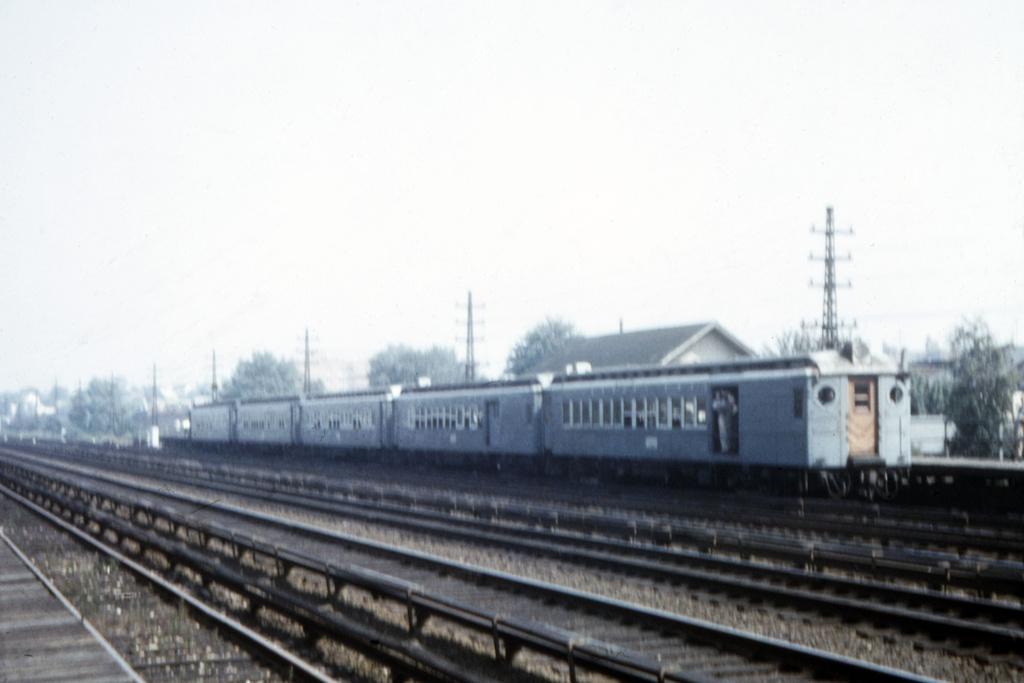 (166k, 1044x710)<br><b>Country:</b> United States<br><b>City:</b> New York<br><b>System:</b> Long Island Rail Road<br><b>Line:</b> LIRR Rockaway<br><b>Location:</b> Rego Park <br><b>Car:</b> LIRR MPB-54  <br><b>Collection of:</b> David Pirmann<br><b>Date:</b> 1956<br><b>Viewed (this week/total):</b> 4 / 3989
