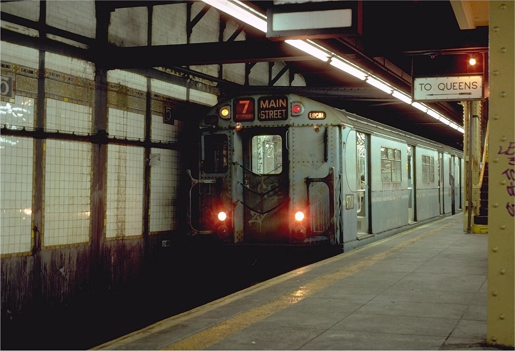 (190k, 1024x698)<br><b>Country:</b> United States<br><b>City:</b> New York<br><b>System:</b> New York City Transit<br><b>Line:</b> IRT Flushing Line<br><b>Location:</b> 5th Avenue <br><b>Route:</b> 7<br><b>Car:</b> R-36 World's Fair (St. Louis, 1963-64) 9711 <br><b>Photo by:</b> Neil Axelrod<br><b>Collection of:</b> Joe Testagrose<br><b>Date:</b> 10/17/1981<br><b>Viewed (this week/total):</b> 3 / 6083