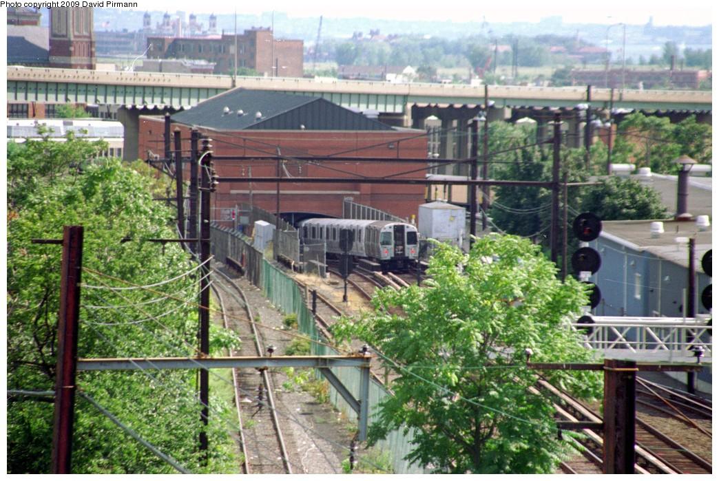 (244k, 1044x699)<br><b>Country:</b> United States<br><b>City:</b> Jersey City, NJ<br><b>System:</b> PATH<br><b>Location:</b> East of Journal Square <br><b>Car:</b> PATH PA  <br><b>Photo by:</b> David Pirmann<br><b>Date:</b> 9/15/1996<br><b>Notes:</b> PATH train heading east into portal, passing Waldo yard (from Waldo Ave pedestrian overpass) <br><b>Viewed (this week/total):</b> 0 / 4491