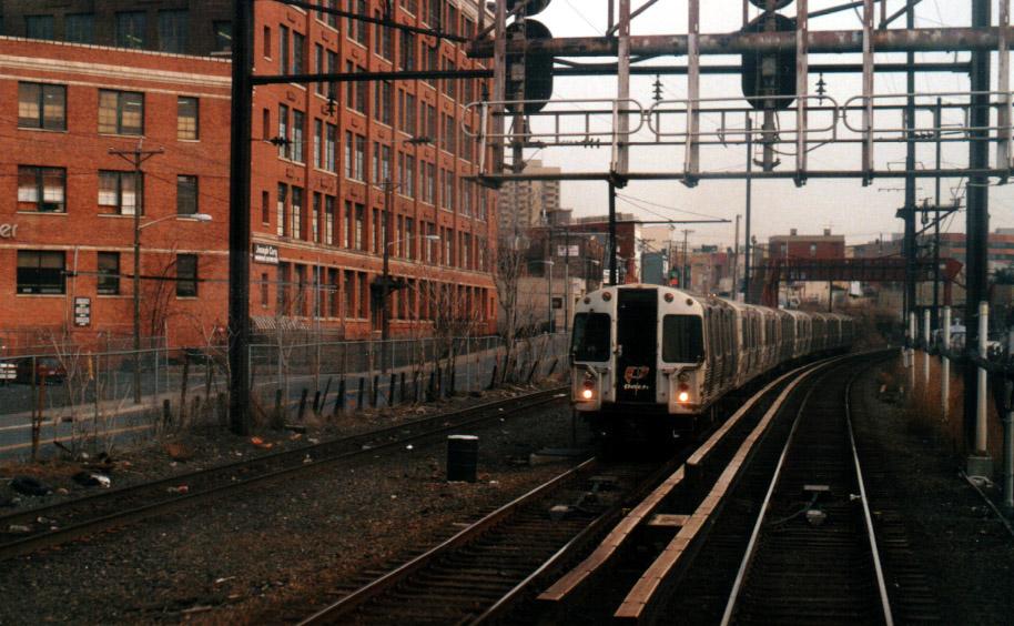 (190k, 914x564)<br><b>Country:</b> United States<br><b>City:</b> Jersey City, NJ<br><b>System:</b> PATH<br><b>Location:</b> West of Journal Square <br><b>Car:</b> PATH PA-4 (Kawasaki, 1986)   <br><b>Photo by:</b> Peter Farrell<br><b>Date:</b> 2/24/2000<br><b>Notes:</b> Path train heading from JSQ to Harrison<br><b>Viewed (this week/total):</b> 0 / 5055