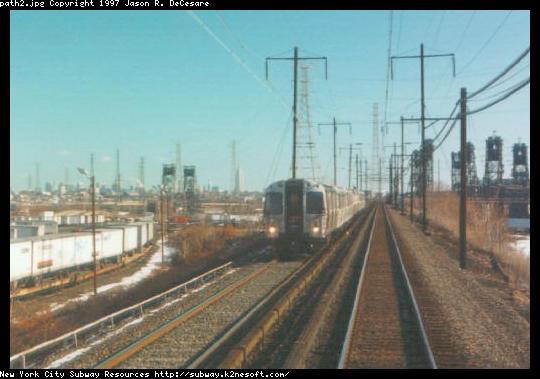 (38k, 540x379)<br><b>Country:</b> United States<br><b>City:</b> Kearny, NJ<br><b>System:</b> PATH<br><b>Location:</b> Kearny-Hack Bridge <br><b>Car:</b> PATH PA  <br><b>Photo by:</b> Jason R. DeCesare<br><b>Notes:</b> PATH train heading west from Hackensack River Drawbridge<br><b>Viewed (this week/total):</b> 1 / 4992
