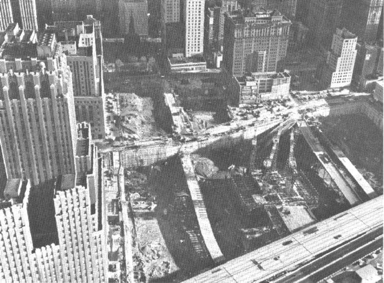 (127k, 757x557)<br><b>Country:</b> United States<br><b>City:</b> New York<br><b>System:</b> PATH<br><b>Location:</b> World Trade Center Construction <br><b>Notes:</b> World Trade Center Construction. Facing east. West Side Highway in bottom foreground. South Hudson Terminal (30 Church St.) building still standing (has TERMINAL sign on top). H&M station underneath. Westbound trackway running top/bottom near center of photo. Photo: Port Authority of New York, as reproduced in <i>ERA Headlights</i>, January 1969.<br><b>Viewed (this week/total):</b> 3 / 23091