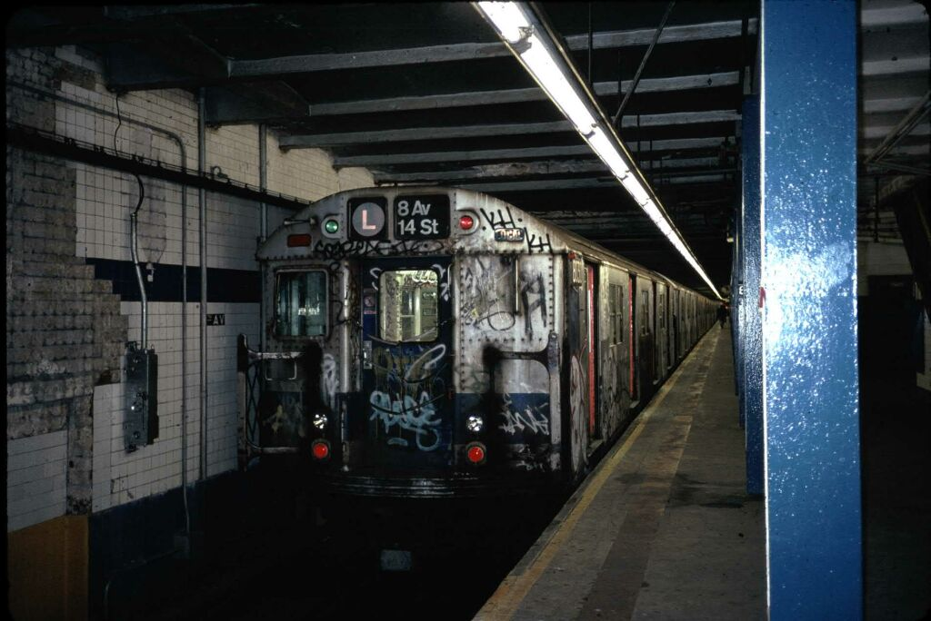 (107k, 1024x684)<br><b>Country:</b> United States<br><b>City:</b> New York<br><b>System:</b> New York City Transit<br><b>Line:</b> BMT Canarsie Line<br><b>Location:</b> 8th Avenue <br><b>Route:</b> L<br><b>Car:</b> R-27 (St. Louis, 1960)  8030 <br><b>Photo by:</b> Glenn L. Rowe<br><b>Date:</b> 9/29/1988<br><b>Viewed (this week/total):</b> 2 / 9272