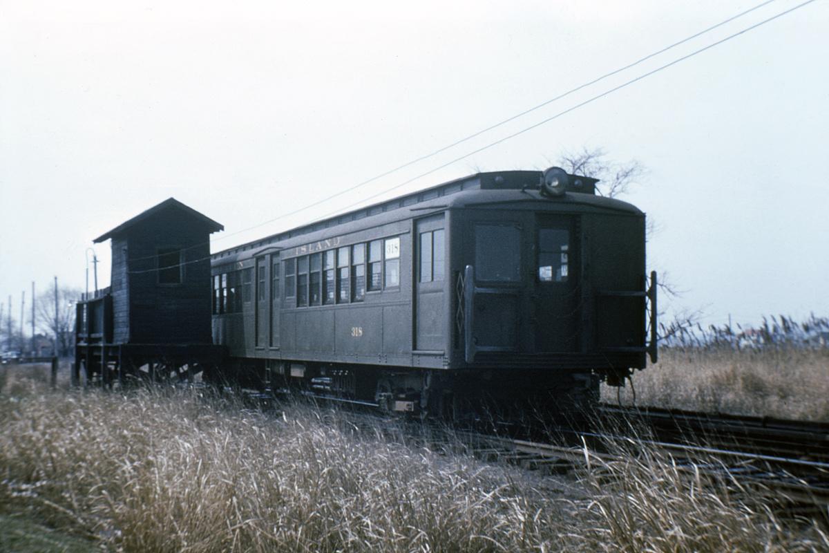 (324k, 1024x683)<br><b>Country:</b> United States<br><b>City:</b> New York<br><b>System:</b> New York City Transit<br><b>Line:</b> SIRT South Beach Line<br><b>Location:</b> Wentworth Avenue <br><b>Car:</b>  318 <br><b>Collection of:</b> David Pirmann<br><b>Date:</b> 3/31/1953<br><b>Notes:</b> South Beach line<br><b>Viewed (this week/total):</b> 2 / 8378