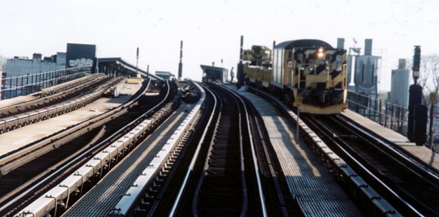(60k, 900x446)<br><b>Country:</b> United States<br><b>City:</b> New York<br><b>System:</b> New York City Transit<br><b>Line:</b> BMT Culver Line<br><b>Location:</b> Ditmas Avenue <br><b>Car:</b> R-77 Locomotive  886 <br><b>Photo by:</b> David of Broadway<br><b>Date:</b> 2/24/2002<br><b>Viewed (this week/total):</b> 0 / 5004