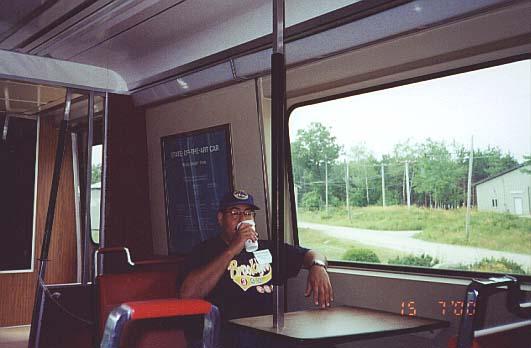 (33k, 531x348)<br><b>Country:</b> United States<br><b>City:</b> Kennebunk, ME<br><b>System:</b> Seashore Trolley Museum <br><b>Car:</b> SOAC  <br><b>Photo by:</b> Thurston Clark<br><b>Date:</b> 7/15/2000<br><b>Notes:</b> SOAC commuter car with Brooklyn customer having his morning coffee while mid-west native looks on<br><b>Viewed (this week/total):</b> 9 / 4935