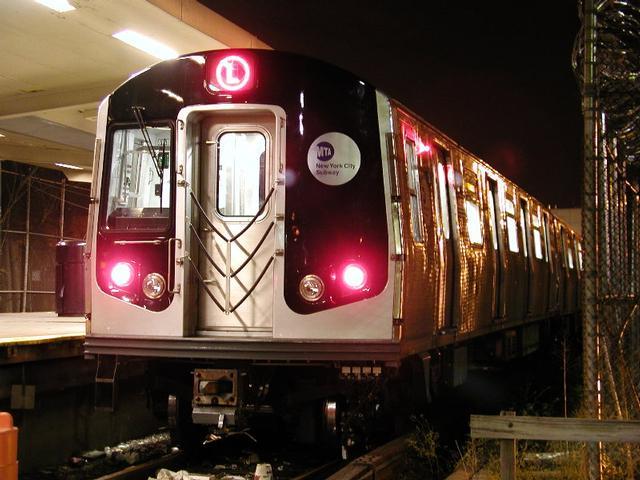 (52k, 640x480)<br><b>Country:</b> United States<br><b>City:</b> New York<br><b>System:</b> New York City Transit<br><b>Line:</b> BMT Canarsie Line<br><b>Location:</b> Rockaway Parkway <br><b>Route:</b> L<br><b>Car:</b> R-143 (Kawasaki, 2001-2002) 8120 <br><b>Photo by:</b> Trevor Logan<br><b>Date:</b> 12/6/2001<br><b>Viewed (this week/total):</b> 0 / 6566