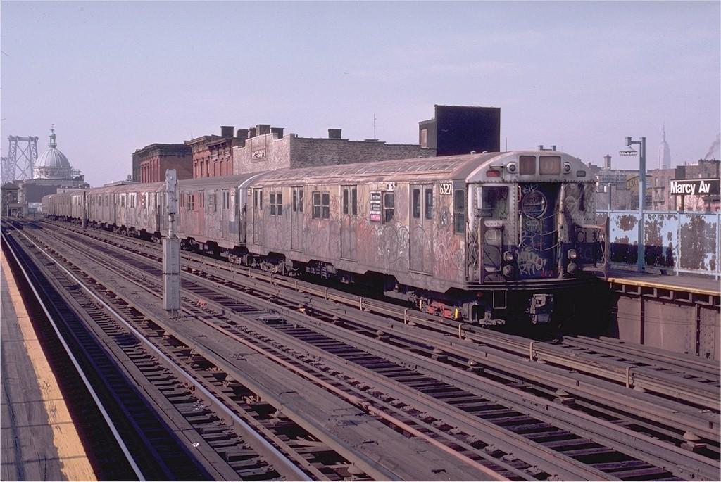 (212k, 1024x685)<br><b>Country:</b> United States<br><b>City:</b> New York<br><b>System:</b> New York City Transit<br><b>Line:</b> BMT Nassau Street/Jamaica Line<br><b>Location:</b> Marcy Avenue <br><b>Route:</b> J<br><b>Car:</b> R-16 (American Car & Foundry, 1955) 6327 <br><b>Photo by:</b> Doug Grotjahn<br><b>Collection of:</b> Joe Testagrose<br><b>Date:</b> 2/21/1983<br><b>Viewed (this week/total):</b> 2 / 5372