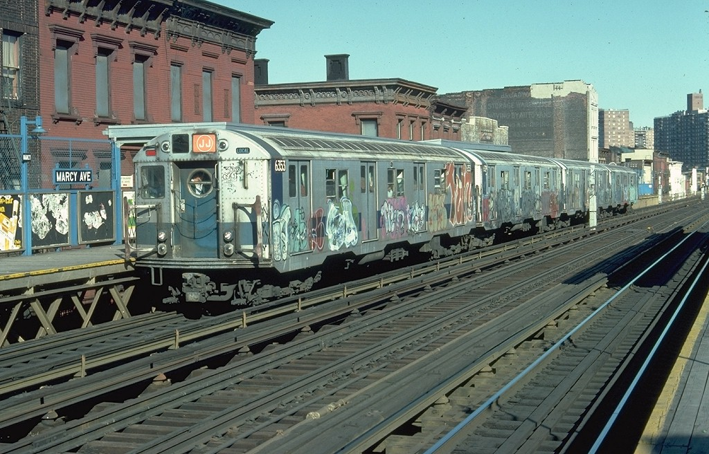 (240k, 1024x656)<br><b>Country:</b> United States<br><b>City:</b> New York<br><b>System:</b> New York City Transit<br><b>Line:</b> BMT Nassau Street/Jamaica Line<br><b>Location:</b> Marcy Avenue <br><b>Route:</b> J<br><b>Car:</b> R-16 (American Car & Foundry, 1955) 6353 <br><b>Photo by:</b> Doug Grotjahn<br><b>Collection of:</b> Joe Testagrose<br><b>Date:</b> 4/10/1977<br><b>Viewed (this week/total):</b> 5 / 6626