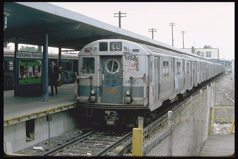 (130k, 768x512)<br><b>Country:</b> United States<br><b>City:</b> New York<br><b>System:</b> New York City Transit<br><b>Line:</b> BMT Canarsie Line<br><b>Location:</b> Rockaway Parkway <br><b>Route:</b> LL<br><b>Car:</b> R-16 (American Car & Foundry, 1955) 6371 <br><b>Photo by:</b> Doug Grotjahn<br><b>Collection of:</b> Joe Testagrose<br><b>Date:</b> 7/1/1977<br><b>Viewed (this week/total):</b> 4 / 5191