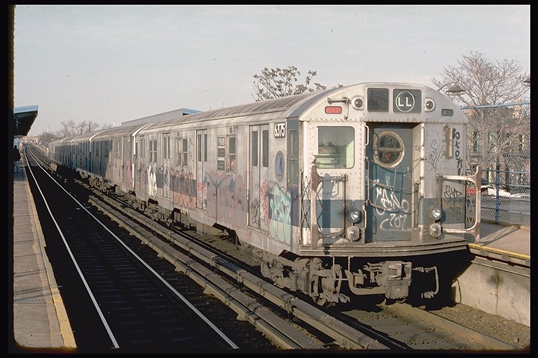 (130k, 768x512)<br><b>Country:</b> United States<br><b>City:</b> New York<br><b>System:</b> New York City Transit<br><b>Line:</b> BMT Canarsie Line<br><b>Location:</b> New Lots Avenue <br><b>Route:</b> LL<br><b>Car:</b> R-16 (American Car & Foundry, 1955) 6375 <br><b>Photo by:</b> Ed McKernan<br><b>Collection of:</b> Joe Testagrose<br><b>Date:</b> 12/22/1976<br><b>Viewed (this week/total):</b> 2 / 4066