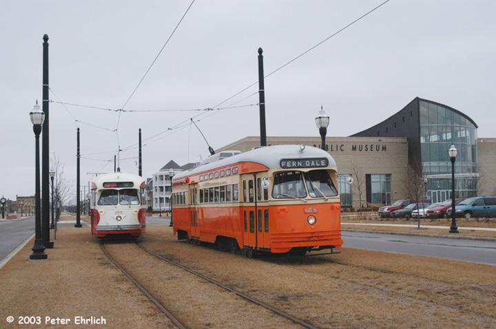 (111k, 720x478)<br><b>Country:</b> United States<br><b>City:</b> Kenosha, WI<br><b>System:</b> Kenosha Electric Railway<br><b>Location:</b> 56th St. & 1st Ave. (Eastbound) <br><b>Car:</b> PCC (TTC Toronto) 4615 <br><b>Photo by:</b> Peter Ehrlich<br><b>Date:</b> 2/22/2003<br><b>Notes:</b> With PCC 4609; Kenosha Public Museum in background<br><b>Viewed (this week/total):</b> 2 / 3827