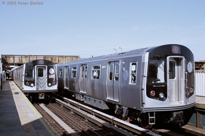 (127k, 720x478)<br><b>Country:</b> United States<br><b>City:</b> New York<br><b>System:</b> New York City Transit<br><b>Line:</b> BMT Canarsie Line<br><b>Location:</b> Livonia Avenue <br><b>Route:</b> L<br><b>Car:</b> R-143 (Kawasaki, 2001-2002) 8108&8301 <br><b>Photo by:</b> Peter Ehrlich<br><b>Date:</b> 3/4/2003<br><b>Notes:</b> This is a meeting of the first production train and the most recently-delivered train, which was undergoing acceptance testing.<br><b>Viewed (this week/total):</b> 0 / 17894