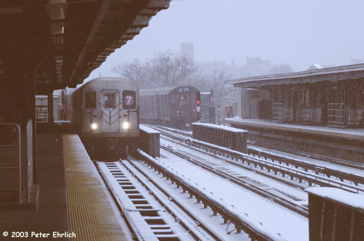 (119k, 720x478)<br><b>Country:</b> United States<br><b>City:</b> New York<br><b>System:</b> New York City Transit<br><b>Line:</b> IRT Flushing Line<br><b>Location:</b> 46th Street/Bliss Street <br><b>Route:</b> 7<br><b>Car:</b> R-62A (Bombardier, 1984-1987)   <br><b>Photo by:</b> Peter Ehrlich<br><b>Date:</b> 3/6/2003<br><b>Notes:</b> R62, R36 trains pass on the curve outside of 46th Street/Bliss Street Station.<br><b>Viewed (this week/total):</b> 2 / 4699