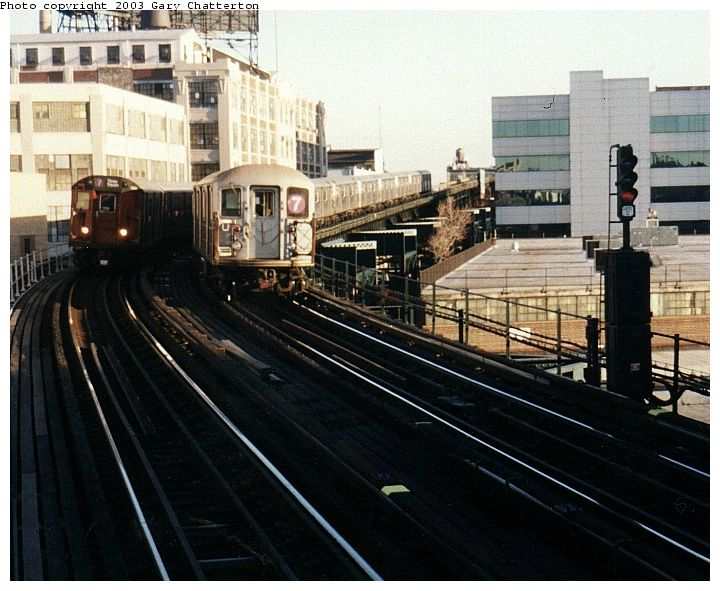 (86k, 720x591)<br><b>Country:</b> United States<br><b>City:</b> New York<br><b>System:</b> New York City Transit<br><b>Line:</b> IRT Flushing Line<br><b>Location:</b> Court House Square/45th Road <br><b>Route:</b> 7<br><b>Car:</b> R-36 Main Line (St. Louis, 1964) 9543 <br><b>Photo by:</b> Gary Chatterton<br><b>Date:</b> 1/2003<br><b>Notes:</b> With R62A 2128<br><b>Viewed (this week/total):</b> 0 / 3630