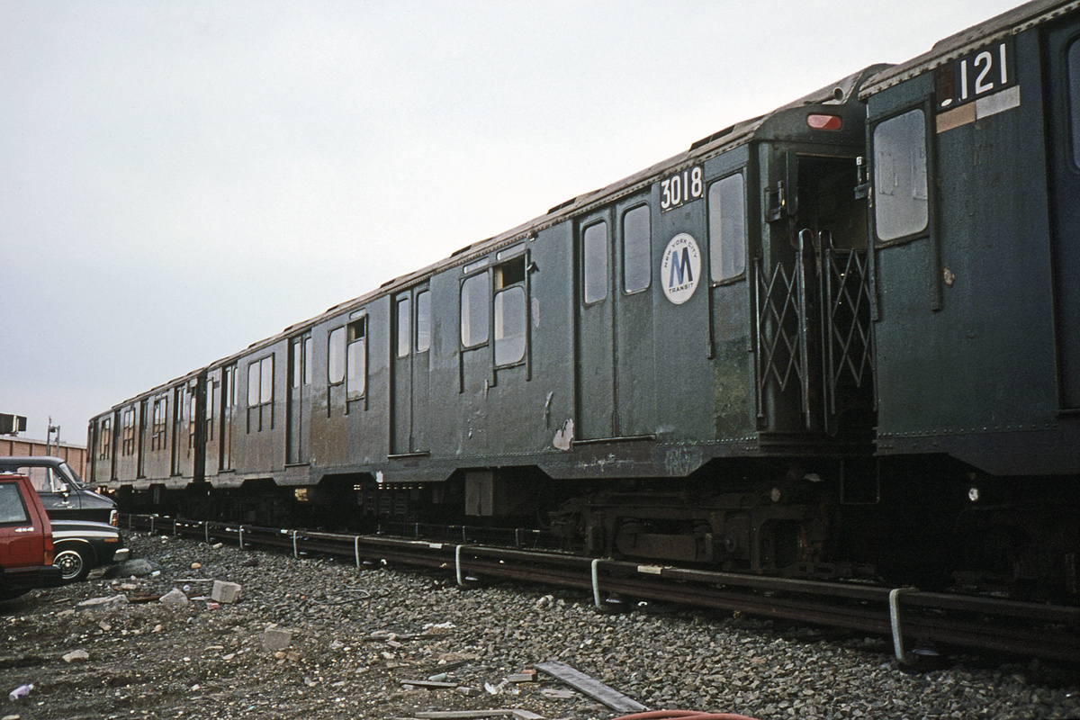 (348k, 1044x709)<br><b>Country:</b> United States<br><b>City:</b> New York<br><b>System:</b> New York City Transit<br><b>Location:</b> Coney Island Yard<br><b>Car:</b> R-10 (American Car & Foundry, 1948) 3121 <br><b>Photo by:</b> Glenn L. Rowe<br><b>Collection of:</b> David Pirmann<br><b>Date:</b> 4/10/1990<br><b>Notes:</b> With R10 3018<br><b>Viewed (this week/total):</b> 6 / 4275