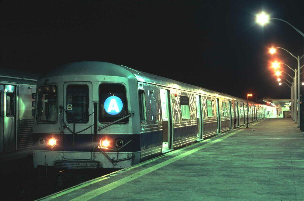 (81k, 1010x668)<br><b>Country:</b> United States<br><b>City:</b> New York<br><b>System:</b> New York City Transit<br><b>Line:</b> IND Rockaway<br><b>Location:</b> Rockaway Park/Beach 116th Street <br><b>Car:</b> R-44 (St. Louis, 1971-73) 310 <br><b>Photo by:</b> Glenn L. Rowe<br><b>Date:</b> 8/17/1991<br><b>Viewed (this week/total):</b> 0 / 7084