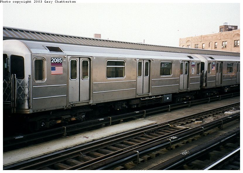 (101k, 830x591)<br><b>Country:</b> United States<br><b>City:</b> New York<br><b>System:</b> New York City Transit<br><b>Line:</b> IRT Flushing Line<br><b>Location:</b> 52nd Street/Lincoln Avenue <br><b>Route:</b> 7<br><b>Car:</b> R-62A (Bombardier, 1984-1987)  2085 <br><b>Photo by:</b> Gary Chatterton<br><b>Date:</b> 4/3/2003<br><b>Viewed (this week/total):</b> 5 / 2432