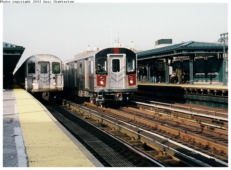 (113k, 810x596)<br><b>Country:</b> United States<br><b>City:</b> New York<br><b>System:</b> New York City Transit<br><b>Line:</b> IRT Woodlawn Line<br><b>Location:</b> 161st Street/River Avenue (Yankee Stadium) <br><b>Route:</b> 4<br><b>Car:</b> R-62 (Kawasaki, 1983-1985)  1566 <br><b>Photo by:</b> Gary Chatterton<br><b>Date:</b> 4/2/2003<br><b>Notes:</b> With R142 7176<br><b>Viewed (this week/total):</b> 3 / 6663