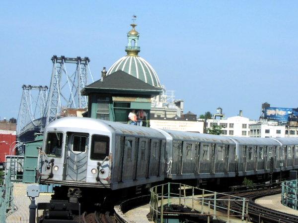 (72k, 600x450)<br><b>Country:</b> United States<br><b>City:</b> New York<br><b>System:</b> New York City Transit<br><b>Line:</b> BMT Nassau Street/Jamaica Line<br><b>Location:</b> Marcy Avenue <br><b>Route:</b> J<br><b>Car:</b> R-42 (St. Louis, 1969-1970)  4877 <br><b>Photo by:</b> Trevor Logan<br><b>Date:</b> 8/29/2001<br><b>Viewed (this week/total):</b> 0 / 4042