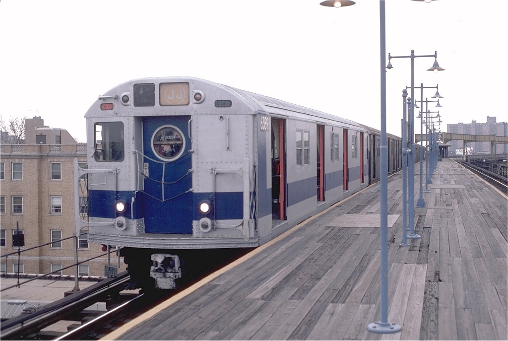 (151k, 1024x687)<br><b>Country:</b> United States<br><b>City:</b> New York<br><b>System:</b> New York City Transit<br><b>Line:</b> BMT Nassau Street/Jamaica Line<br><b>Location:</b> Alabama Avenue <br><b>Route:</b> J<br><b>Car:</b> R-16 (American Car & Foundry, 1955) 6389 <br><b>Photo by:</b> Doug Grotjahn<br><b>Collection of:</b> Joe Testagrose<br><b>Date:</b> 1/30/1983<br><b>Notes:</b> (There was some discussion about the date of this photo-- that it was from the late 60s-- but the blue & silver exterior and tan & orange interiors didn't appear together till the late 70s.)<br><b>Viewed (this week/total):</b> 8 / 6395