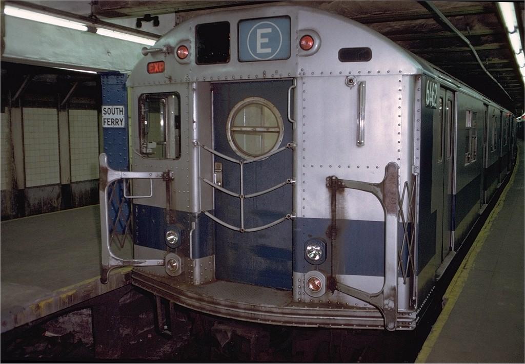 (194k, 1024x711)<br><b>Country:</b> United States<br><b>City:</b> New York<br><b>System:</b> New York City Transit<br><b>Line:</b> BMT Broadway Line<br><b>Location:</b> Whitehall Street <br><b>Route:</b> E<br><b>Car:</b> R-16 (American Car & Foundry, 1955) 6462 <br><b>Photo by:</b> Doug Grotjahn<br><b>Collection of:</b> Joe Testagrose<br><b>Date:</b> 12/5/1971<br><b>Viewed (this week/total):</b> 3 / 4475