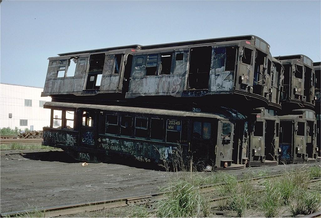 (255k, 1024x697)<br><b>Country:</b> United States<br><b>City:</b> New York<br><b>System:</b> New York City Transit<br><b>Location:</b> Scrapyard<br><b>Car:</b> Low-V 20349 (ex-5447)<br><b>Photo by:</b> Ed McKernan<br><b>Collection of:</b> Joe Testagrose<br><b>Date:</b> 5/29/1977<br><b>Viewed (this week/total):</b> 0 / 9300