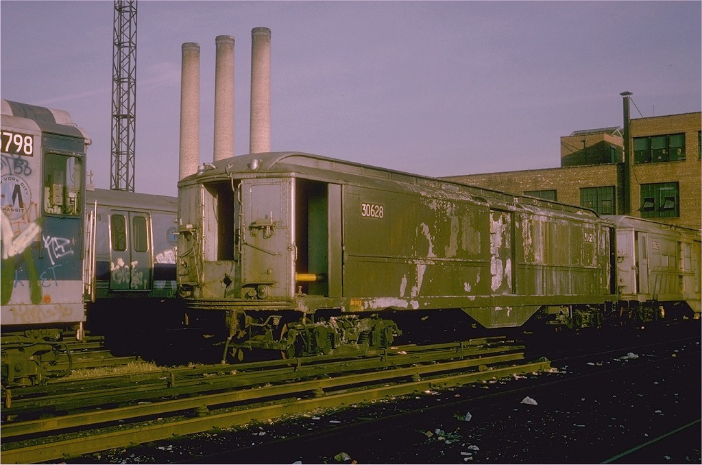 (184k, 1024x678)<br><b>Country:</b> United States<br><b>City:</b> New York<br><b>System:</b> New York City Transit<br><b>Location:</b> 207th Street Yard<br><b>Car:</b> Low-V 30628 (ex-5594)<br><b>Photo by:</b> Steve Zabel<br><b>Collection of:</b> Joe Testagrose<br><b>Date:</b> 12/23/1974<br><b>Viewed (this week/total):</b> 0 / 3911