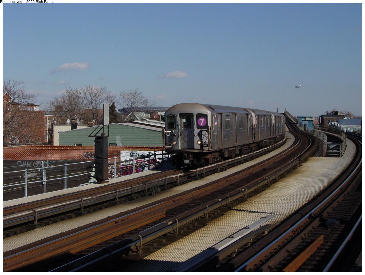 (75k, 820x620)<br><b>Country:</b> United States<br><b>City:</b> New York<br><b>System:</b> New York City Transit<br><b>Line:</b> IRT Flushing Line<br><b>Location:</b> 103rd Street/Corona Plaza <br><b>Route:</b> 7<br><b>Car:</b> R-62A (Bombardier, 1984-1987)  2147 <br><b>Photo by:</b> Richard Panse<br><b>Date:</b> 1/20/2003<br><b>Viewed (this week/total):</b> 0 / 3460