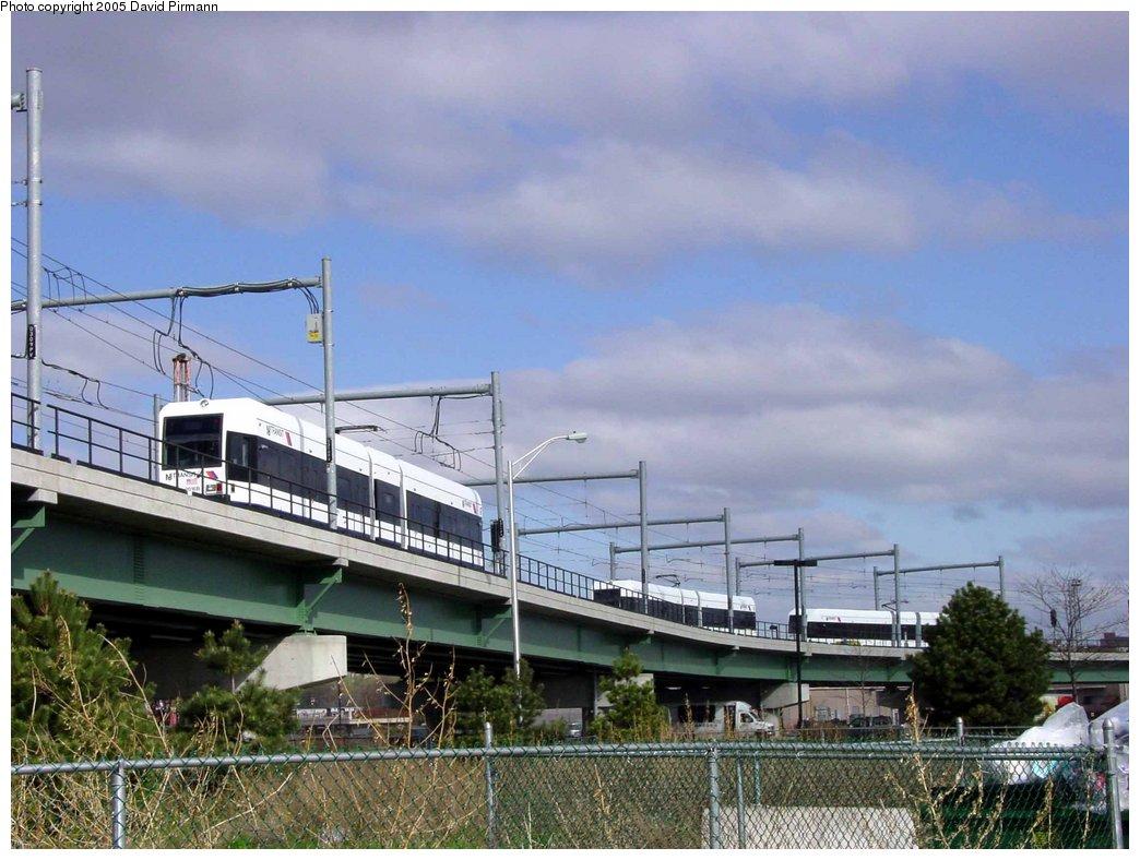 (168k, 1044x788)<br><b>Country:</b> United States<br><b>City:</b> Jersey City, NJ<br><b>System:</b> Hudson Bergen Light Rail<br><b>Location:</b> Between Newport & Hoboken <br><b>Photo by:</b> David Pirmann<br><b>Date:</b> 4/24/2003<br><b>Notes:</b> Three-way meet of HBLR cars: one northbound, one in pocket track, one southbound<br><b>Viewed (this week/total):</b> 1 / 3546