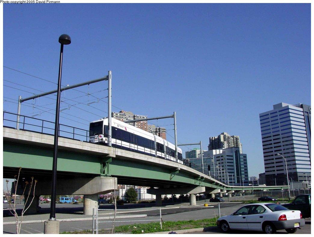 (151k, 1044x788)<br><b>Country:</b> United States<br><b>City:</b> Jersey City, NJ<br><b>System:</b> Hudson Bergen Light Rail<br><b>Location:</b> Between Newport & Hoboken <br><b>Photo by:</b> David Pirmann<br><b>Date:</b> 4/28/2003<br><b>Notes:</b> Southbound car heading to Newport<br><b>Viewed (this week/total):</b> 0 / 3642