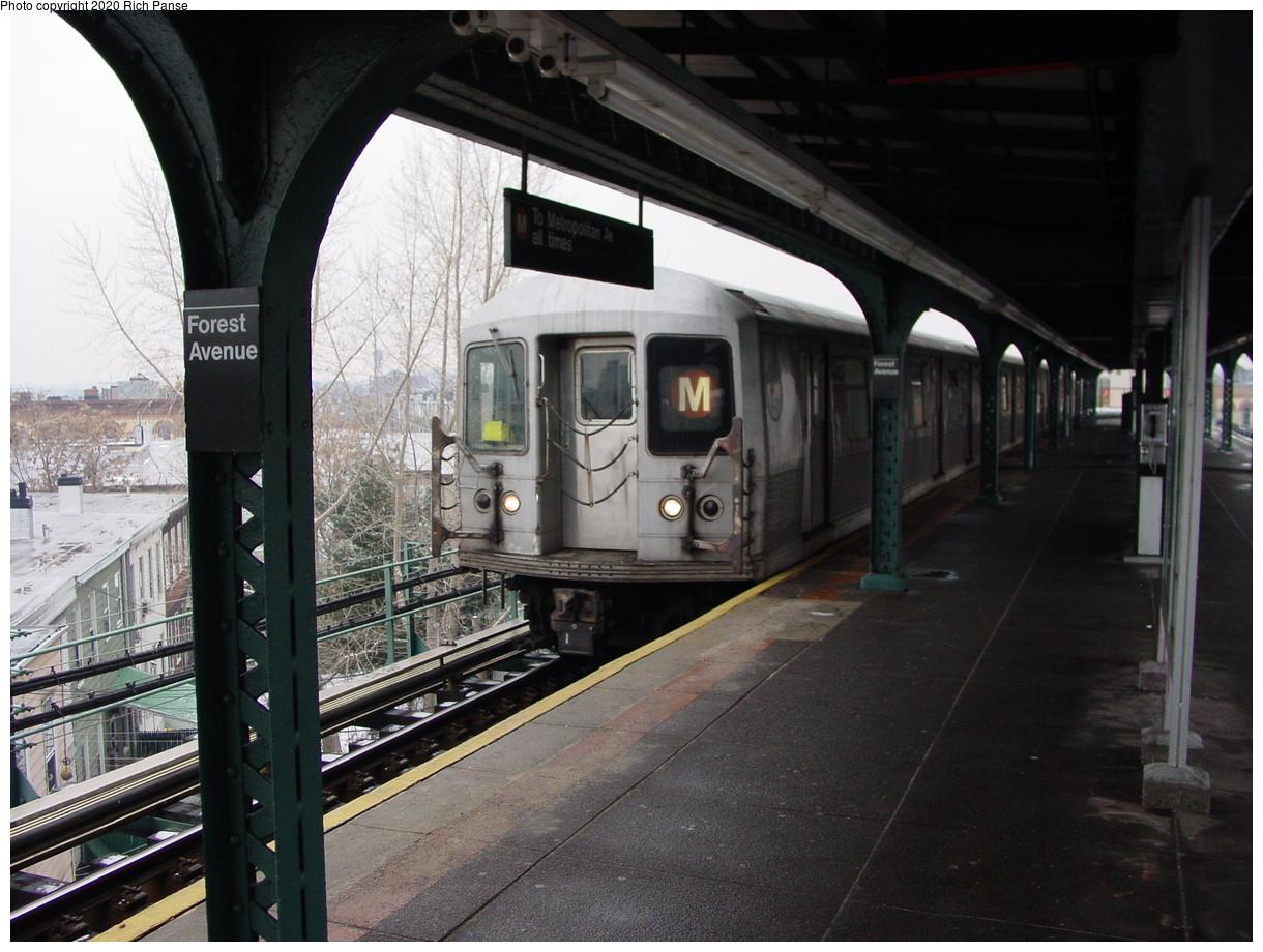 (78k, 820x620)<br><b>Country:</b> United States<br><b>City:</b> New York<br><b>System:</b> New York City Transit<br><b>Line:</b> BMT Myrtle Avenue Line<br><b>Location:</b> Forest Avenue <br><b>Route:</b> M<br><b>Car:</b> R-42 (St. Louis, 1969-1970)   <br><b>Photo by:</b> Richard Panse<br><b>Date:</b> 1/29/2003<br><b>Viewed (this week/total):</b> 0 / 5297