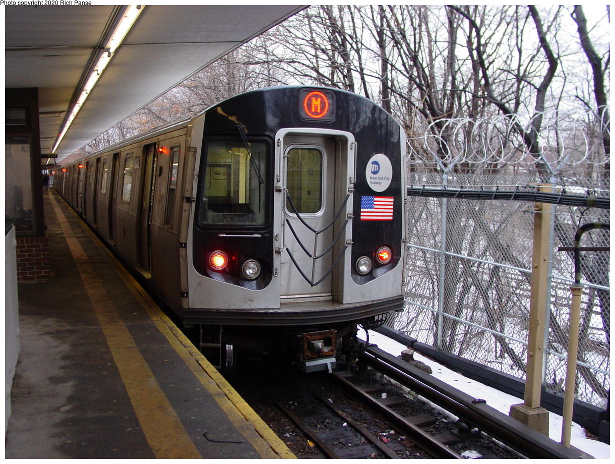 (116k, 820x620)<br><b>Country:</b> United States<br><b>City:</b> New York<br><b>System:</b> New York City Transit<br><b>Line:</b> BMT Myrtle Avenue Line<br><b>Location:</b> Metropolitan Avenue <br><b>Route:</b> M<br><b>Car:</b> R-143 (Kawasaki, 2001-2002) 8136 <br><b>Photo by:</b> Richard Panse<br><b>Date:</b> 2/23/2003<br><b>Viewed (this week/total):</b> 2 / 7868
