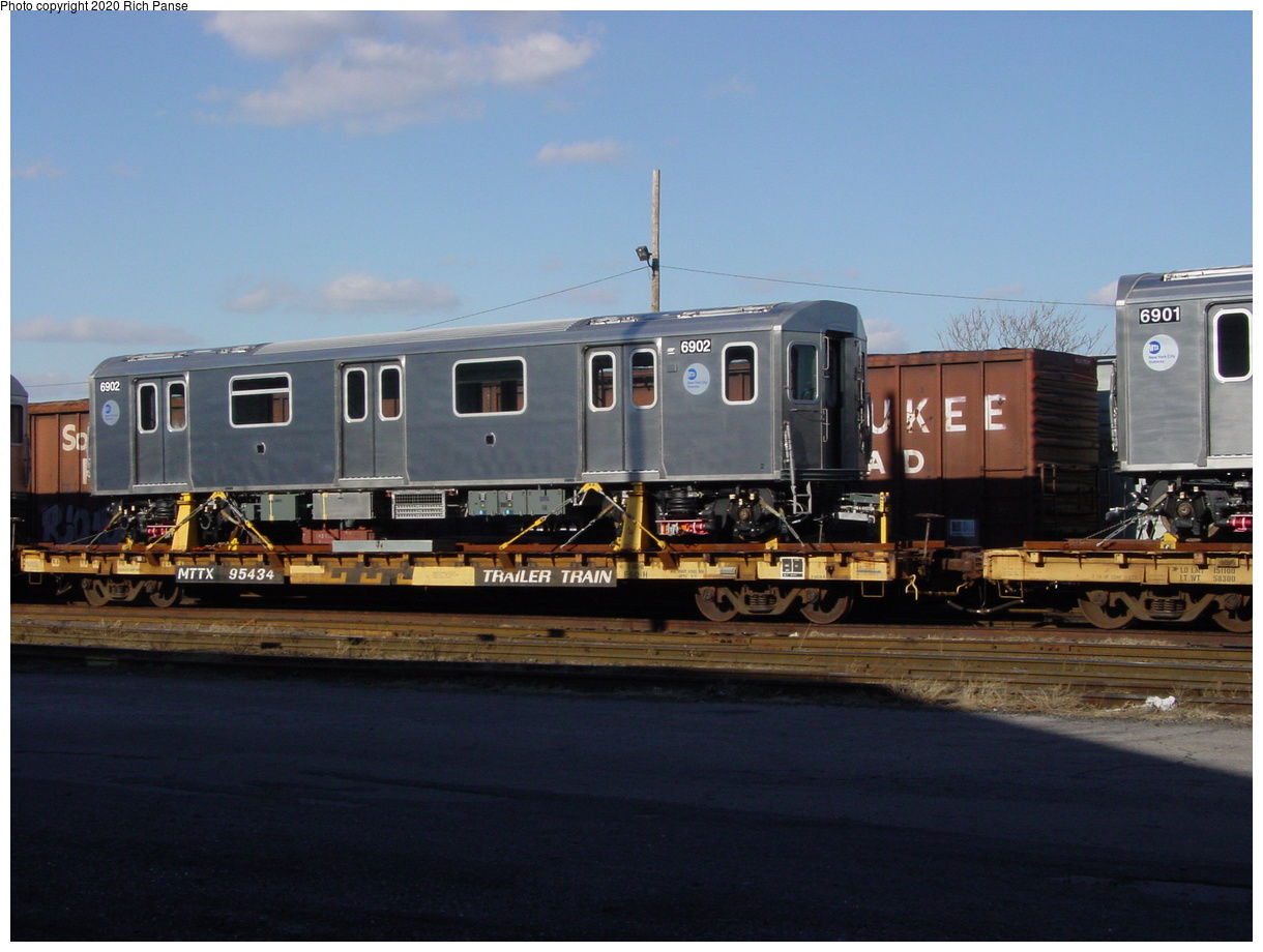 (61k, 820x620)<br><b>Country:</b> United States<br><b>City:</b> New York<br><b>System:</b> New York City Transit<br><b>Location:</b> LIRR/NY & Atlantic RR Fresh Pond Yard <br><b>Car:</b> R-142 (Primary Order, Bombardier, 1999-2002)  6902 <br><b>Photo by:</b> Richard Panse<br><b>Date:</b> 1/21/2003<br><b>Viewed (this week/total):</b> 0 / 5997