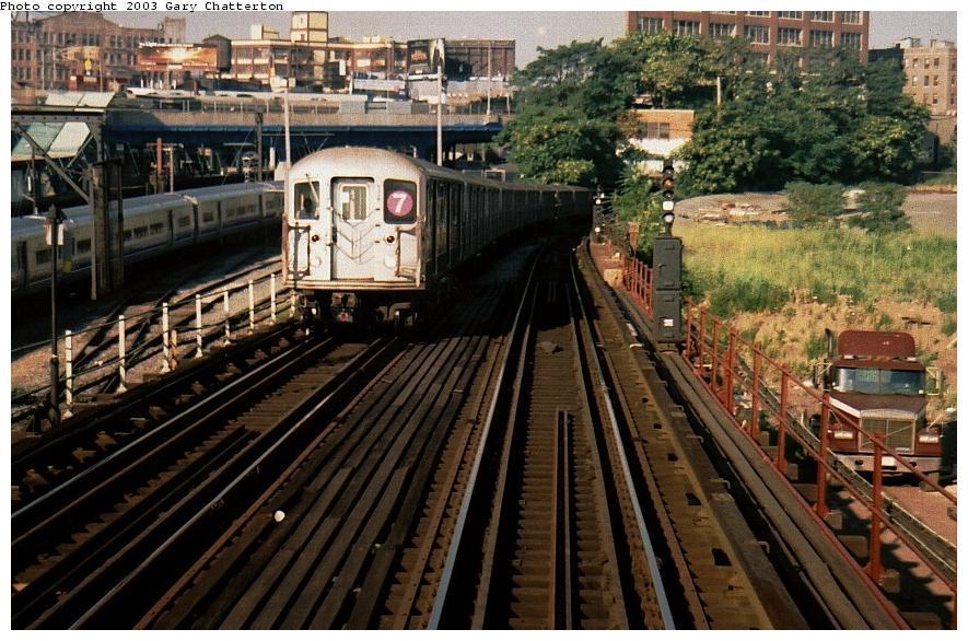 (113k, 885x586)<br><b>Country:</b> United States<br><b>City:</b> New York<br><b>System:</b> New York City Transit<br><b>Line:</b> IRT Flushing Line<br><b>Location:</b> Viaduct approach east of Hunterspoint Ave. <br><b>Route:</b> 7<br><b>Car:</b> R-62A (Bombardier, 1984-1987)  2153 <br><b>Photo by:</b> Gary Chatterton<br><b>Date:</b> 8/2002<br><b>Viewed (this week/total):</b> 3 / 5531
