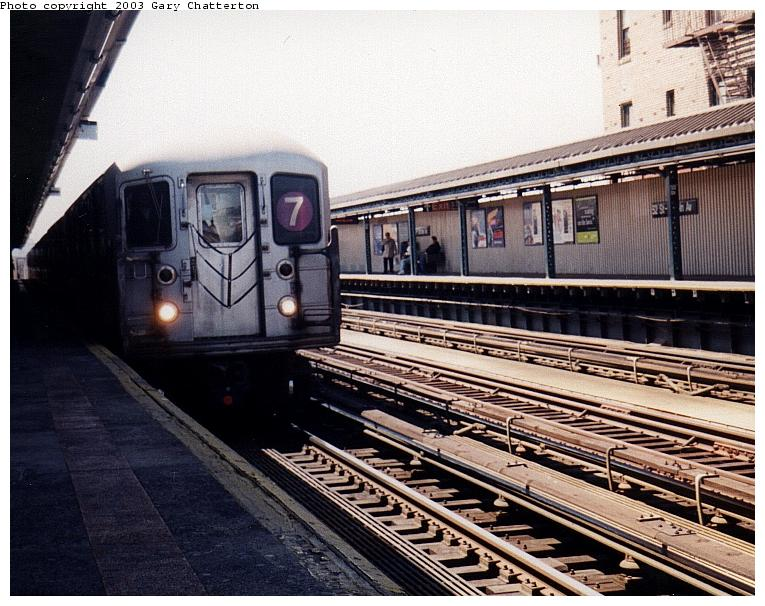 (94k, 765x606)<br><b>Country:</b> United States<br><b>City:</b> New York<br><b>System:</b> New York City Transit<br><b>Line:</b> IRT Flushing Line<br><b>Location:</b> 52nd Street/Lincoln Avenue <br><b>Route:</b> 7<br><b>Car:</b> R-62A (Bombardier, 1984-1987)  1696 <br><b>Photo by:</b> Gary Chatterton<br><b>Date:</b> 5/2003<br><b>Viewed (this week/total):</b> 1 / 2769